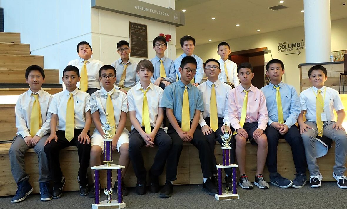 SEEALL Academy chess team with their trophy after a tournament win
