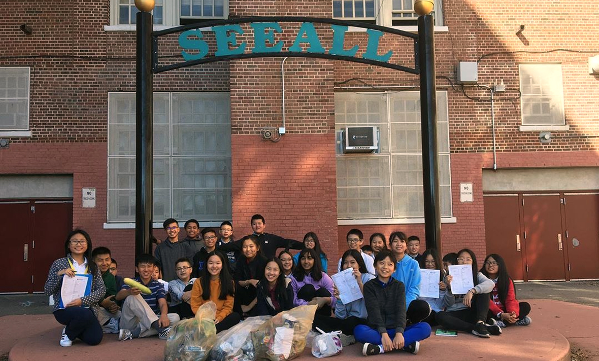 8AL Citizen Science students collecting trash in the school yard