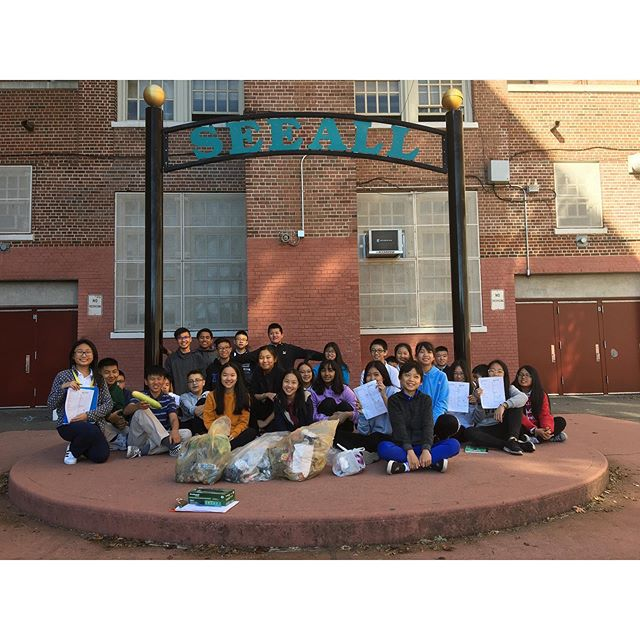 Group of students in the school yard under the SEEALL sign