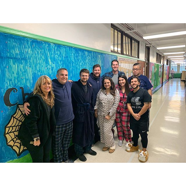 Teachers in the hallway wearing their pajamas for pajama day